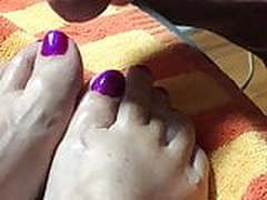 Purple painted toes with cum