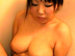 Smoking sexy oriental milf gets gives a oral-service