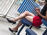 Sexy Asian milf shoe dangling heels in skirt